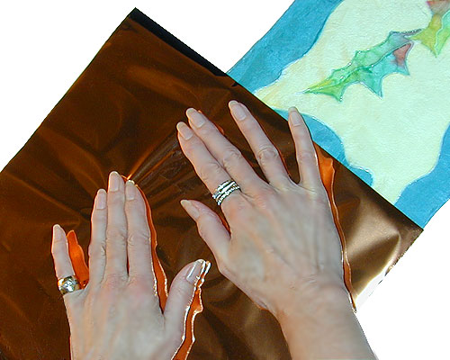 Firmly press foil onto glue